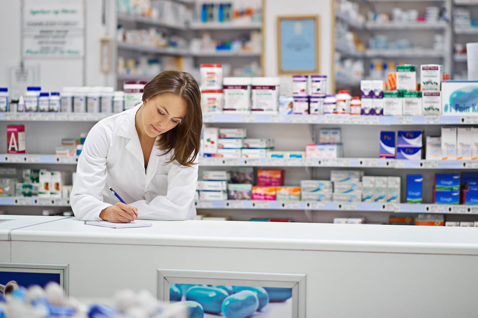 Shot of an pharmacist working at the prescription counter.