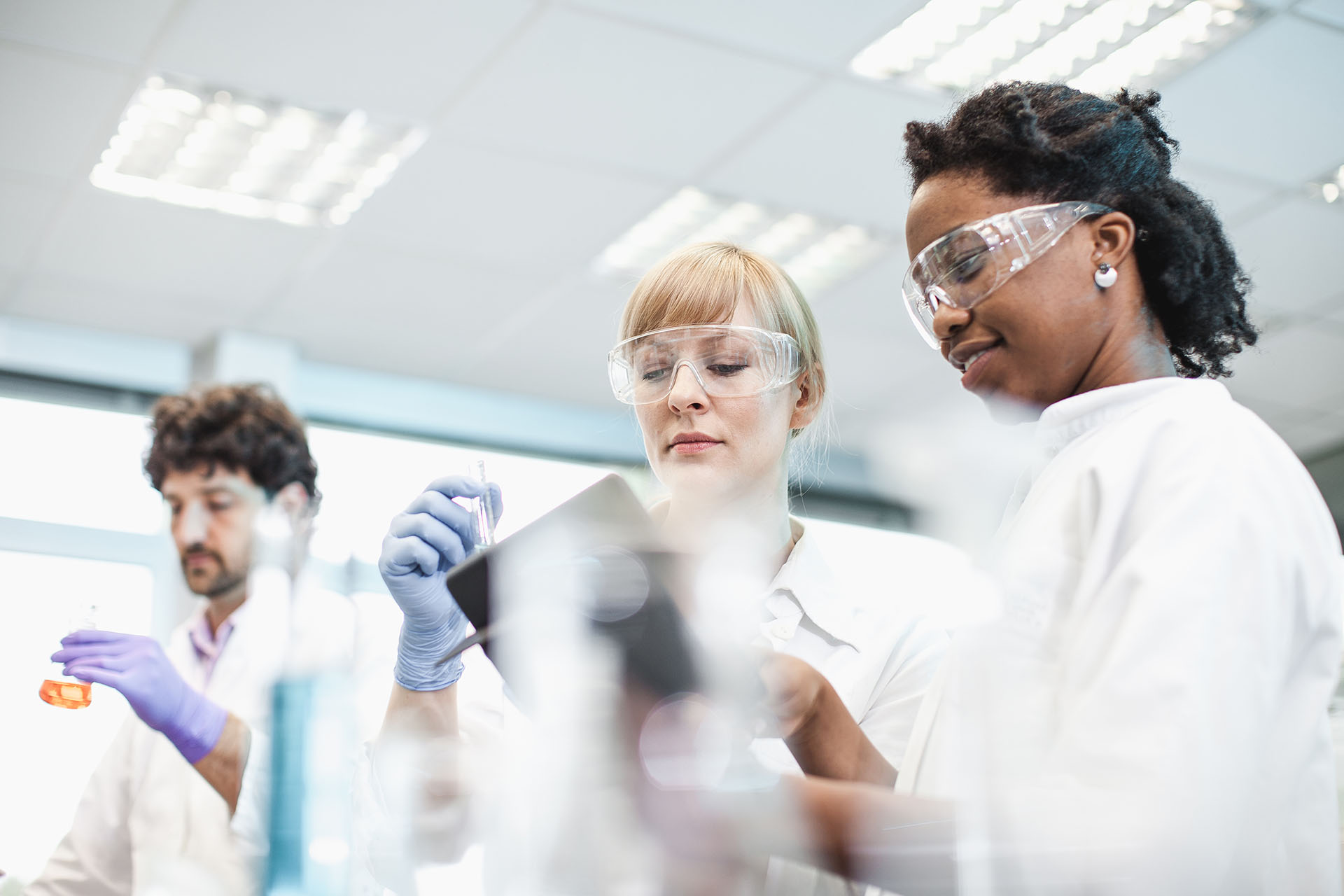 Three students in a science laboratory